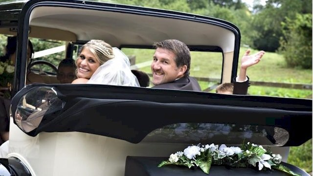 The Bride and Groom being driven away in our Bramwith limousine