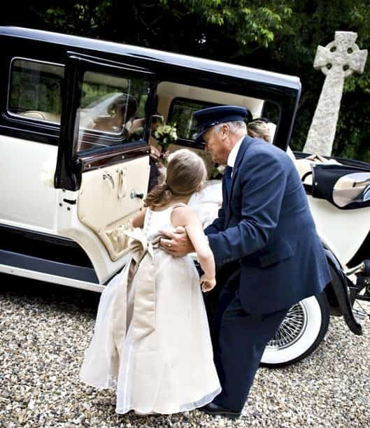 Our driver helping the Bridesmaids into the Bramwith limousine