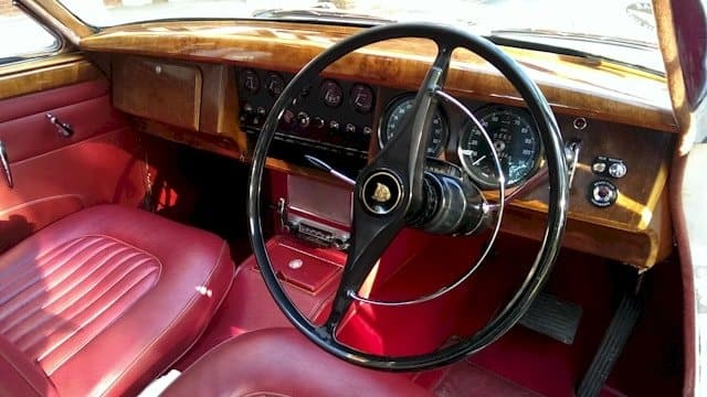 Interior view of our Jaguar Mk2 showing the front seats and walnut dashboard